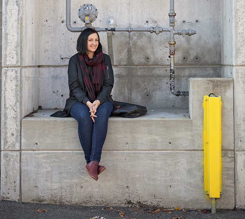 Photo of Jane Vorbrodt sitting in a concrete alcove.